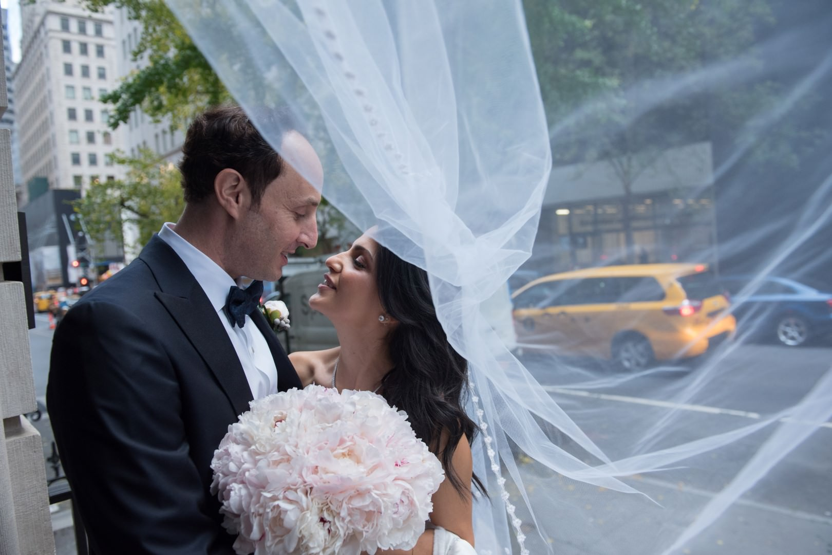 new york city artistic beautiful art wedding photography photographer photo groom bride emotional kiss walking street under veil wind