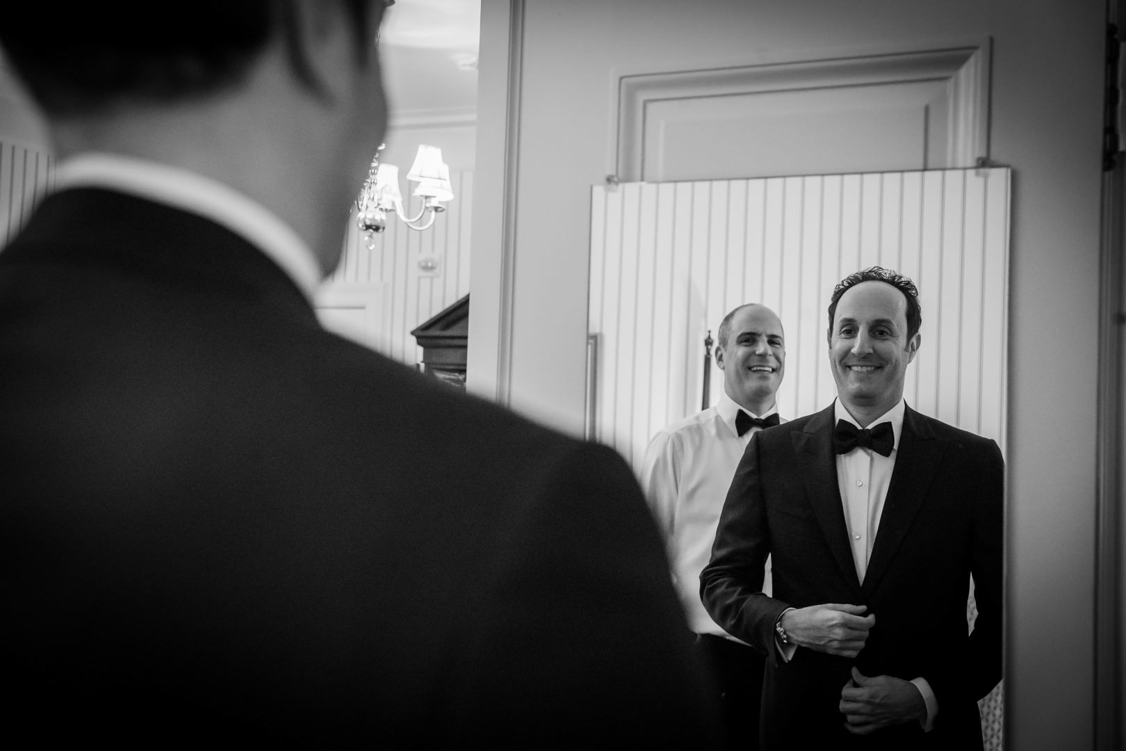 new york city wedding photography photographer photo groom getting ready looking mirror reflection